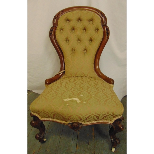 22 - A Victorian spoon back upholstered salon chair with carved hardwood frame and button back, on porcel...
