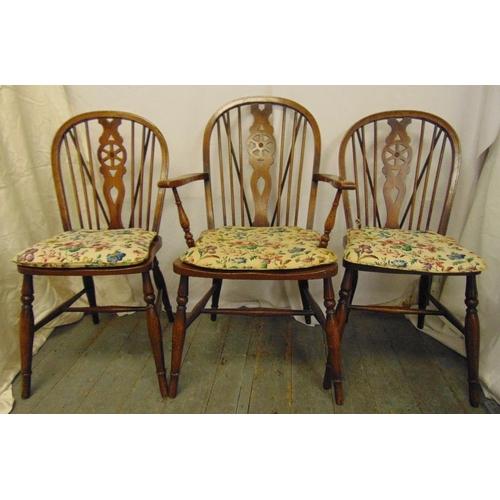 24 - Three Windsor chairs with cushion seats...