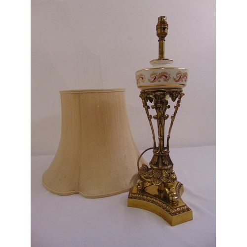 30 - A gilt metal and porcelain table lamp on triform base with silk shade...