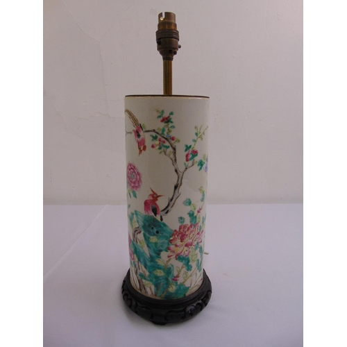 32 - A famille verte cylindrical table lamp decorated with flowers and birds on hardwood stand...