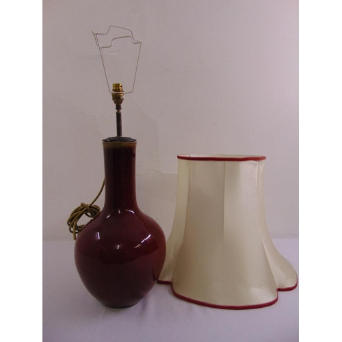 33 - Chinese ox blood red baluster vase converted to a table lamp, to include silk shade...