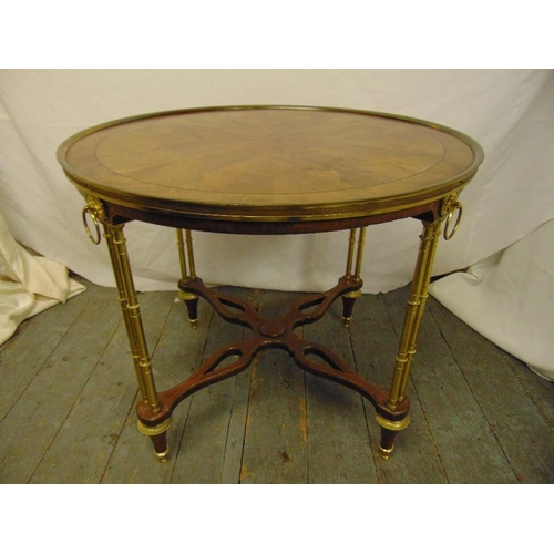 23 - A continental gilded metal and mahogany circular occasional table on simulated bamboo brass legs...