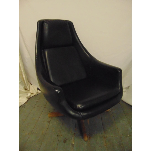 29 - Black leather occasional chair on revolving pedestal base, circa 1970...