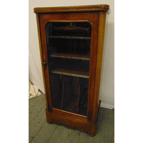 3 - A Victorian mahogany rectangular music cabinet with hinged glazed door...