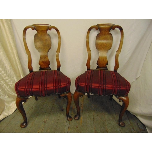 32 - A pair of mahogany and walnut 18th century style dining chairs with upholstered seats and cabriole l...
