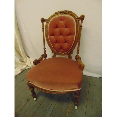35 - A Victorian gilded wooden boudoir chair, upholstered on turned legs...