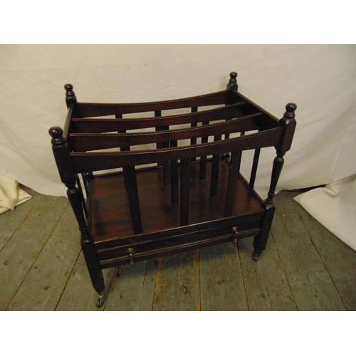 39 - Mahogany rectangular magazine rack with slatted sides on original castors...