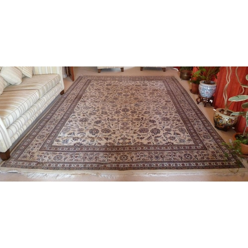 47 - A cream ground Persian carpet with repeating floral pattern and border, 3.7m x 2.8m...
