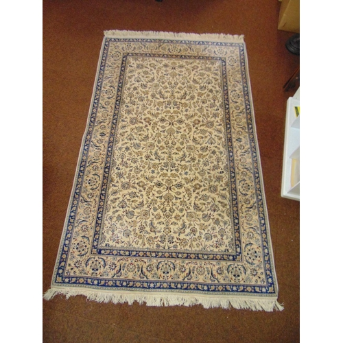 49 - A Persian wool carpet cream ground with repeating floral pattern and blue floral border, 254 x 155cm...