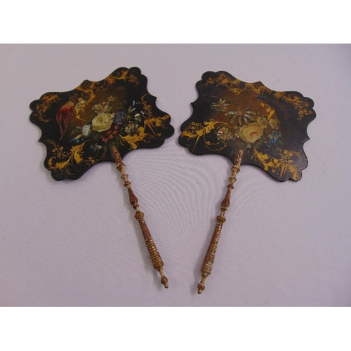 258 - A pair of Victorian hand painted wooden hand held fire guards with turned wooden handles...