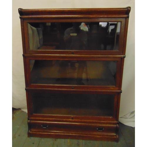 1 - Globe Wernicke rectangular three section glazed bookcase on single drawer base and top plinth...