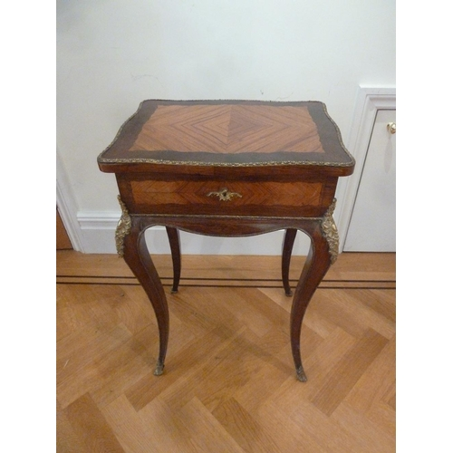11 - A French Louis XVI style rectangular side table with hinged top on cabriole legs...