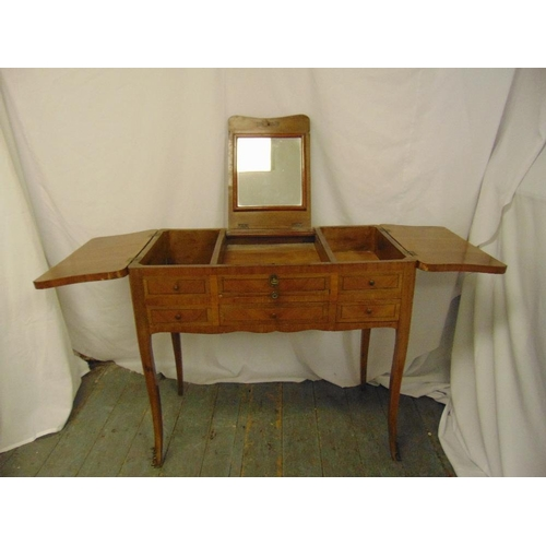 12 - A rectangular kingswood dressing table, the central section lifts to reveal a dressing table mirror,...