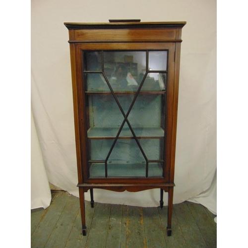 16 - An Edwardian rectangular mahogany glazed inlaid display cabinet on four tapering rectangular legs...