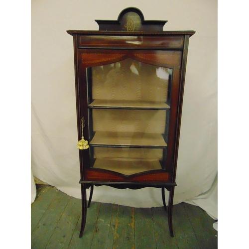 17 - An Edwardian rectangular mahogany glazed display cabinet on four outswept legs...