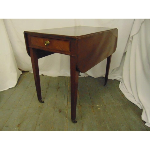 18 - An Edwardian rectangular mahogany drop flap table with single drawer on four tapering rectangular le...