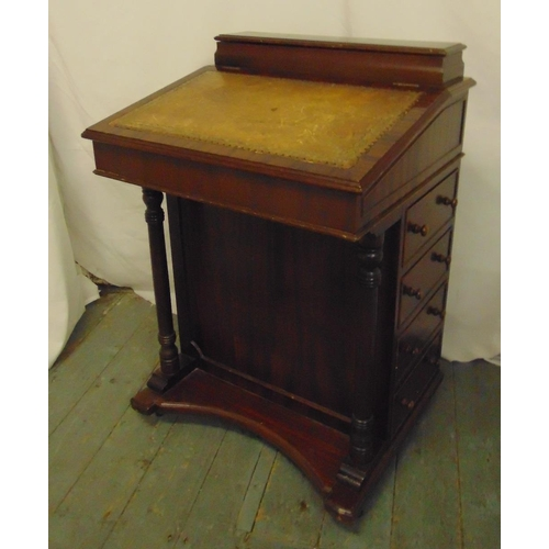 2 - A rectangular mahogany Davenport with tooled leather top and four drawers on shaped rectangular base...