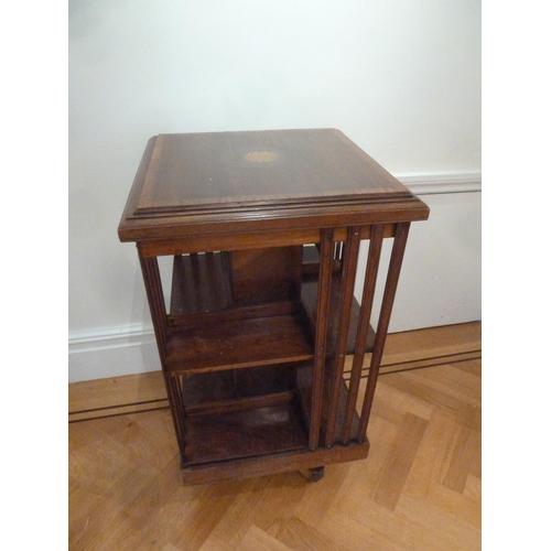 23 - An Edwardian mahogany inlaid revolving rectangular book stand...