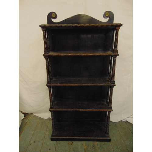 25 - A mahogany rectangular five tier whatnot with turned column supports, swan neck pediment on rectangu...