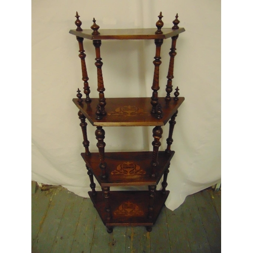 26 - A Victorian four tier mahogany whatnot with turned baluster columns on four block feet...