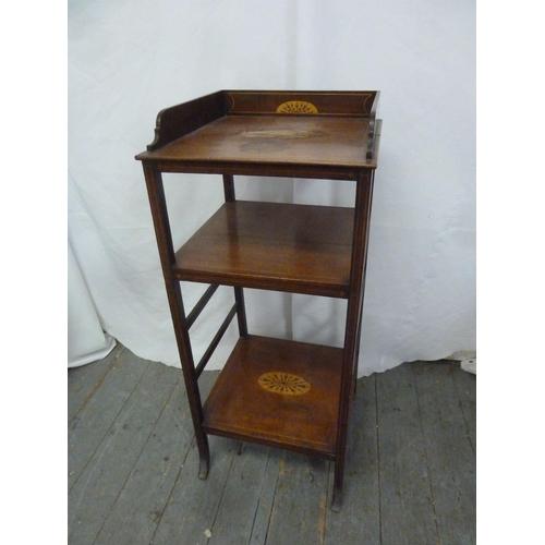 27 - An Edwardian rectangular mahogany inlaid three tier whatnot...