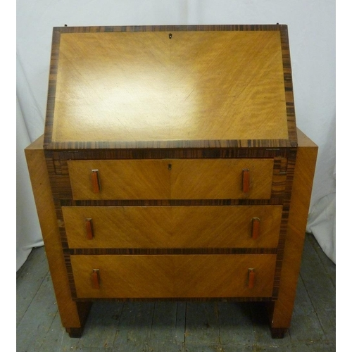 3 - A rectangular Art Deco satinwood bureau with coromandel borders, three drawers with Bakelite handles...