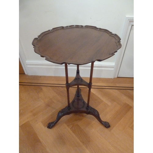 30 - A mahogany tea table circular Chippendale style border on three outswept legs...