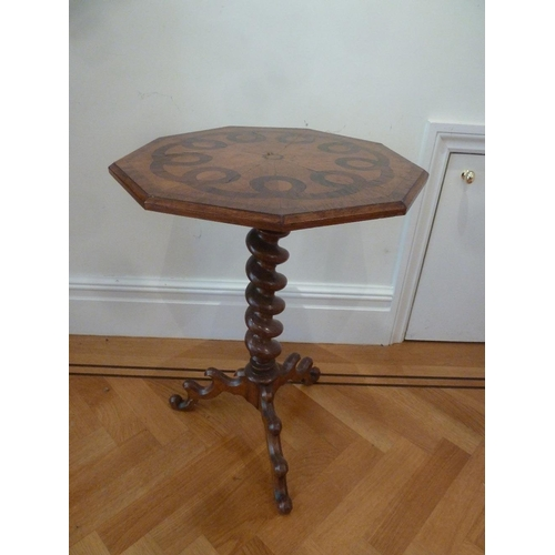 31 - An inlaid side table with octagonal top on barley twist support with outswept legs...