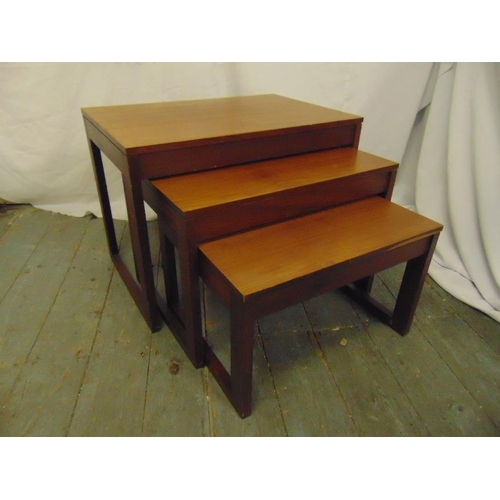 35 - A nest of three rectangular teak side tables...