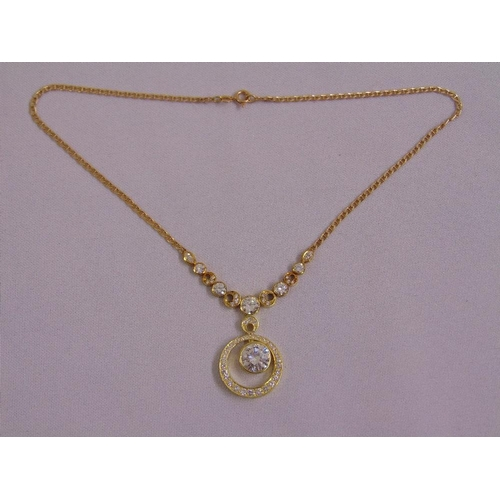 371 - A 14ct yellow gold and diamond pendant necklace set with graduated brilliant cut and marquise diamon...