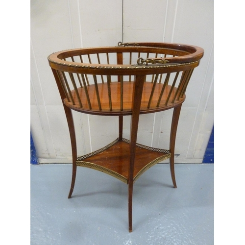 38 - An oval wooden plant stand with slatted sides, swing handle on four cabriole legs...