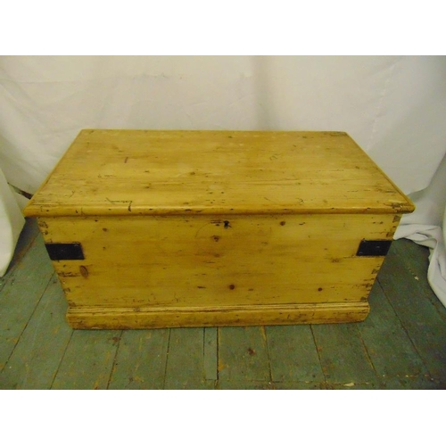 39 - A Victorian rectangular pine blanket box with hinged cover and metal brackets...