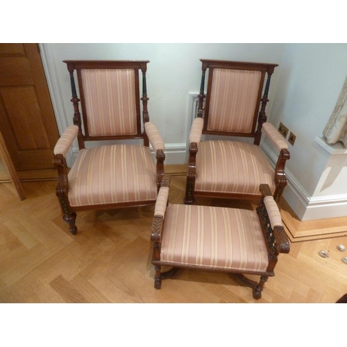 42 - A pair of mahogany upholstered occasional chairs and a matching foot stool...