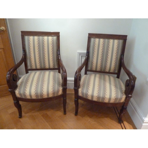 44 - A pair of mahogany upholstered armchairs with scrolling arms and legs...
