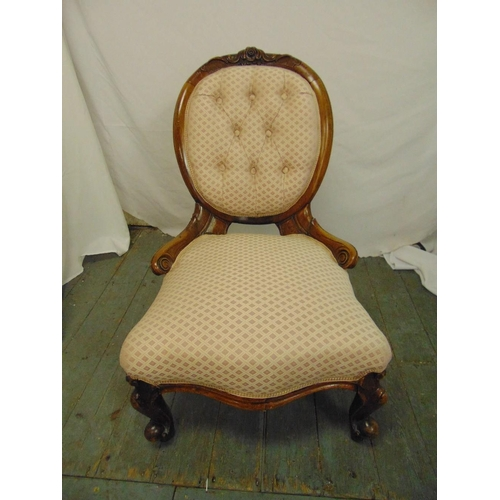 46 - A Victorian upholstered button back boudoir chair on scroll legs...