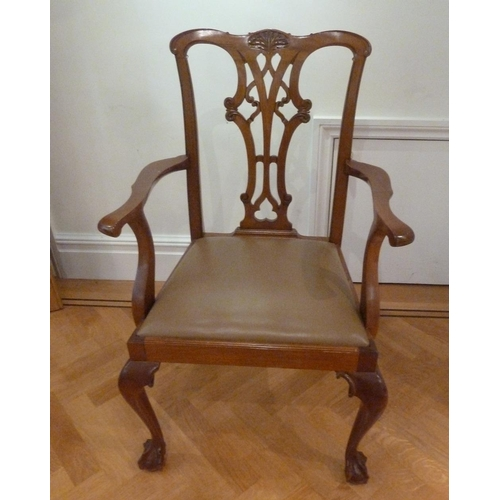 48 - A Chippendale style mahogany armchair, pierced slatted back and scroll legs...