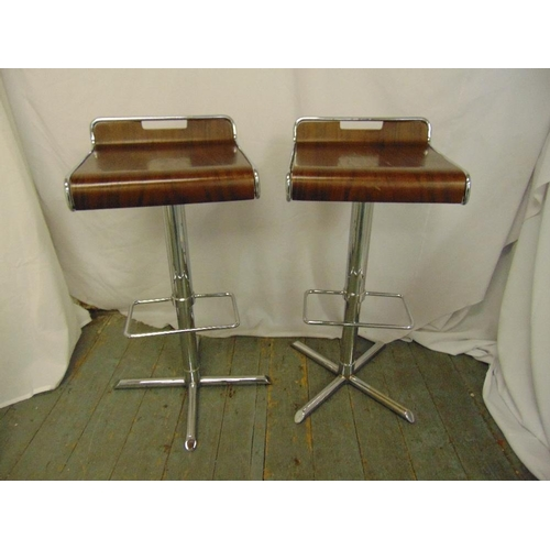 51 - A pair of bentwood and chrome bar stools...