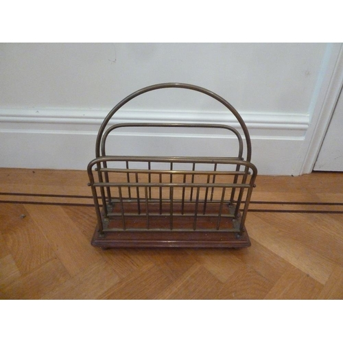 53 - A brass and mahogany rectangular magazine rack with central carrying handle...