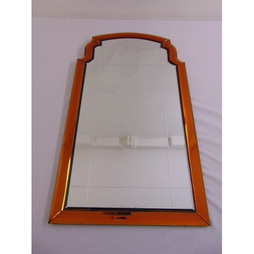 54 - An Art Deco style shaped rectangular wall mirror with amber faceted glass border...