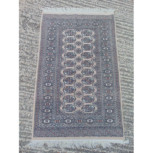 56 - A Bokhara wool carpet, brown ground with repeating geometric pattern,  149 x 96cm...