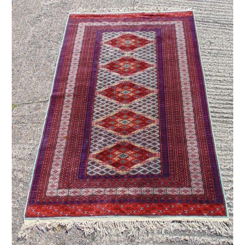 58 - Persian wool carpet with geometric repeating pattern and border, predominately reds, blues and orang...