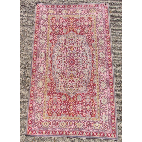 59 - Persian style wool red ground prayer rug with repeating geometric motif and border, 106 x 63cm, A/F...