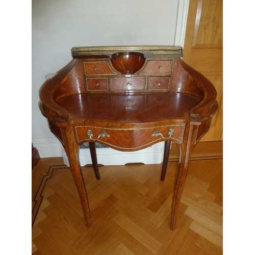 7 - A kingswood shaped oval inlaid desk with gallery and six drawers on cabriole legs...