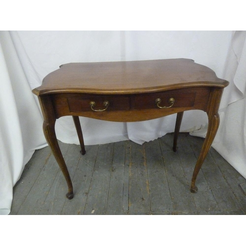 8 - A rectangular mahogany desk with two drawers and brass swing handles on four cabriole legs...