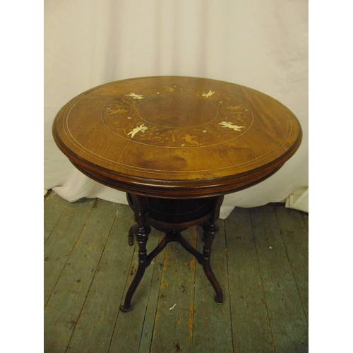 10 - An Edwardian circular occasional table inlaid with satinwood and bone, on cabriole legs...
