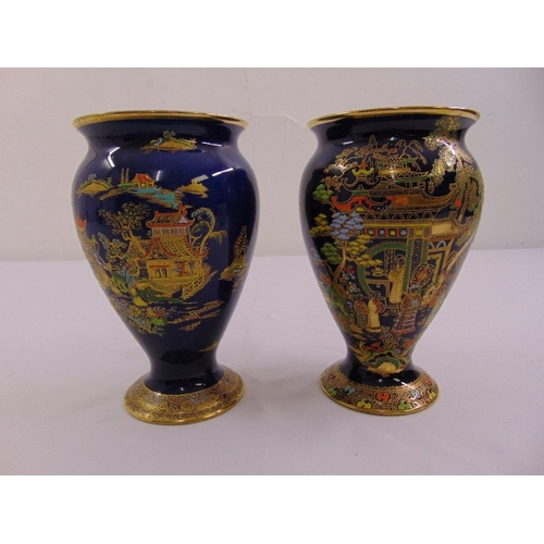128 - A pair of Carltonware Chinoiserie pattern baluster vases with everted rims and raised circular bases...