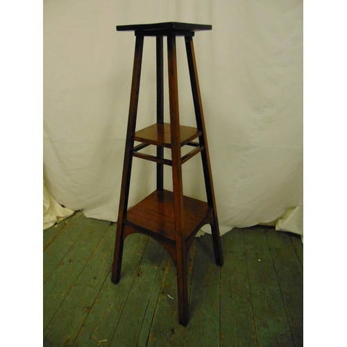 14 - A mahogany arts and crafts plant stand, the square sections with rectangular supports...