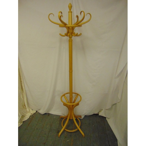 15 - A bentwood hat and coat stand of customary form on four outswept legs...