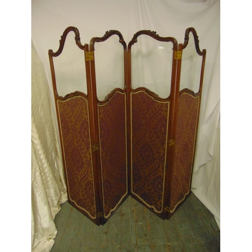 16 - A French mahogany and glazed four panel screen decorated with material panels with stylised leaf and...