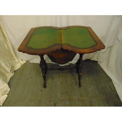 2 - A 19th century walnut and mahogany games and sewing table of shaped rectangular form on four knopped...